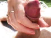 Wife doing a handjob outdoor with cumming in her hands